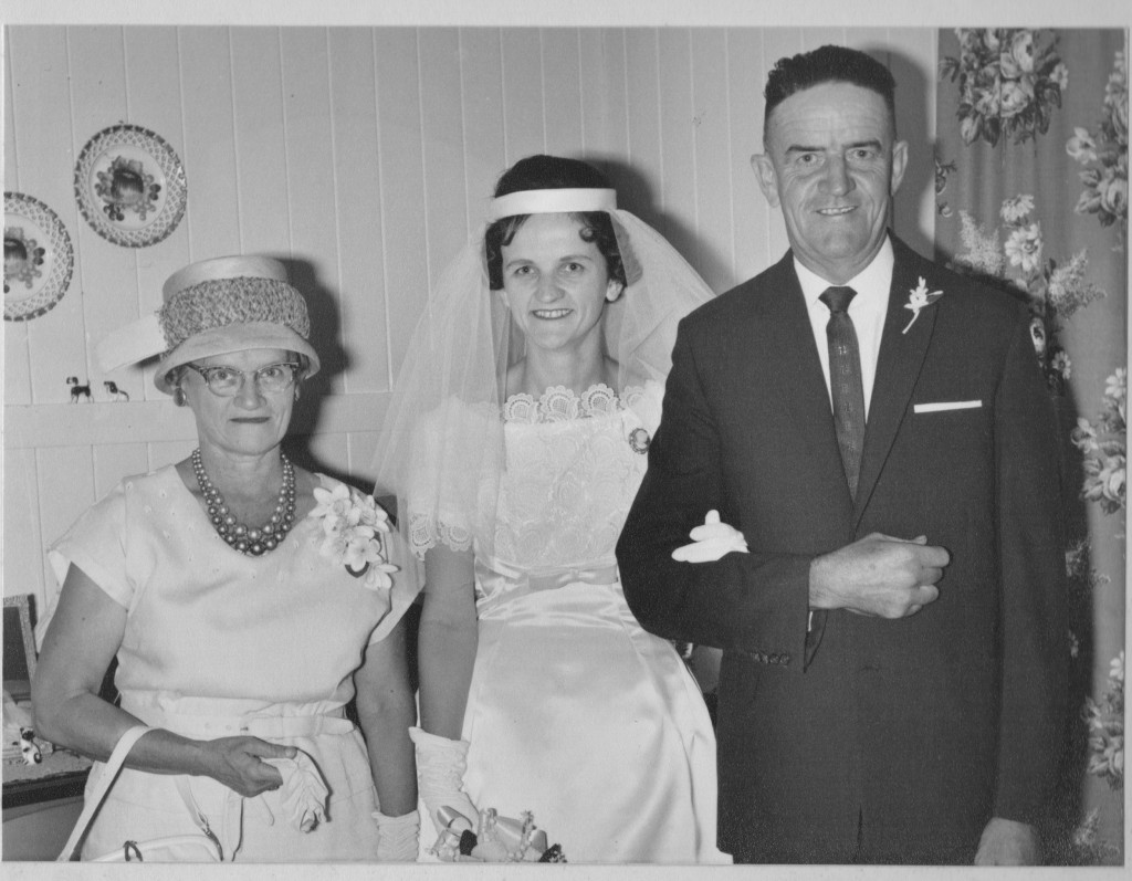 My grandparents with Mum on her wedding day.